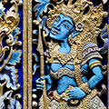 indonésie: Fascinating woodcarving on doors represents some mytical figures.